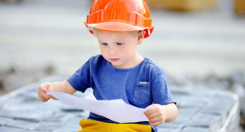 Young boy wearing construction hat