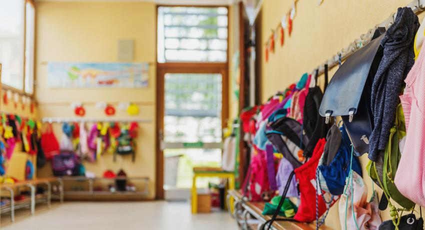 Photo of backpacks in a child care center