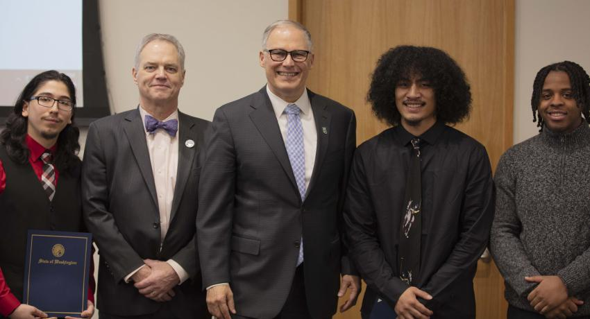 Governor Inslee and Ross Hunter with three young men
