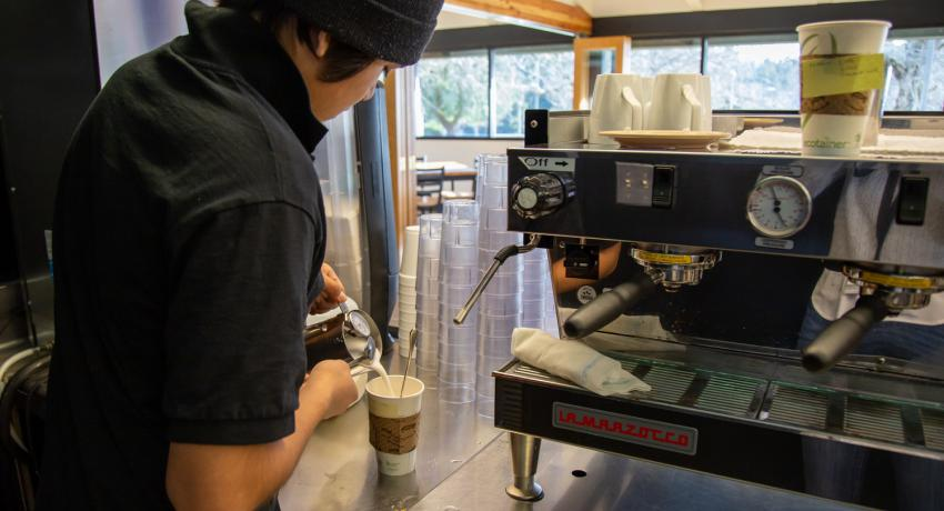 youth pouring coffee